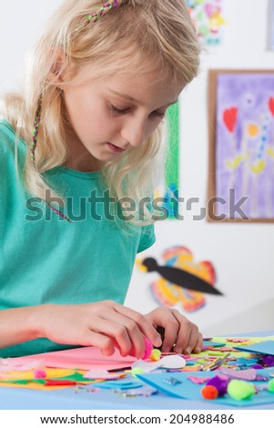Beautiful young girl at art lessons at school