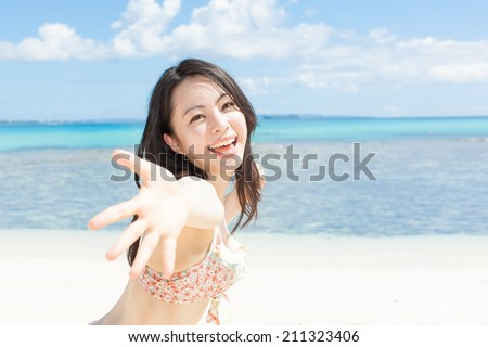 beautiful young girl calling someone on tropical island beach