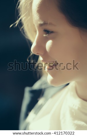 Beautiful young girl closeup with smiling face sunny day outdoor