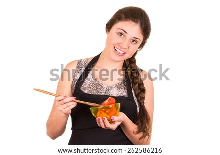beautiful young girl cooking red fresh tomatoes isolated on white - stock photo