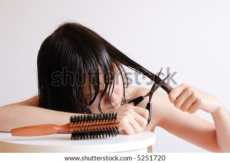 Beautiful Young Girl Cutting Her Wet Hair - stock photo
