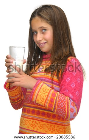 Beautiful young girl drinking milk against a white background