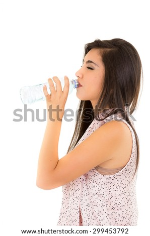 Beautiful young girl drinking water from a plastic bottle with eyes closed isolated on white - stock photo