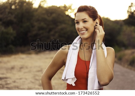 beautiful young girl feeling good after training in nature  - stock photo