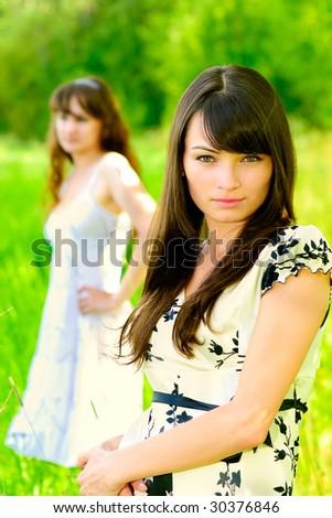 Beautiful young girl-friends. - stock photo