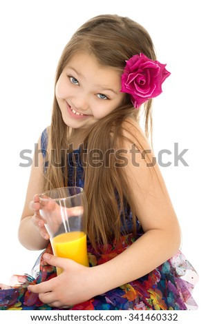 Beautiful young girl holding a glass of orange juice. Closeup-Isolated on white background - stock photo