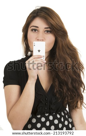 Beautiful young girl holding ace of clubs card in front of her mouth isolated on white - stock photo