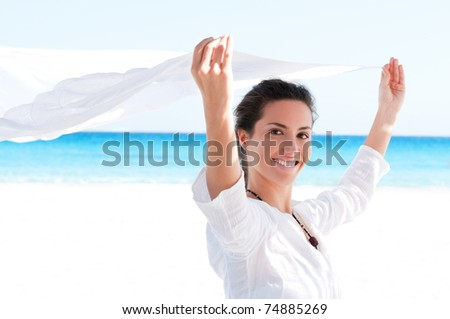 Beautiful young girl holding white fabric at wind in a summer vacation - stock photo