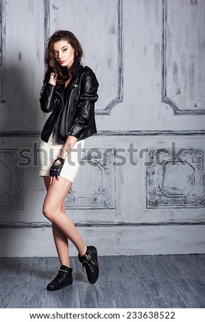 Beautiful young girl in a black blazer - stock photo