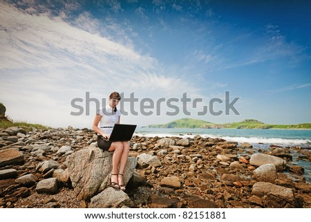 beautiful young girl in a business suit in an outdoor - stock photo