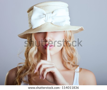 beautiful young girl in a hat - stock photo