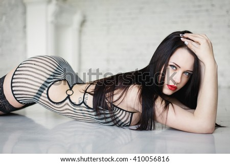Beautiful young girl in a sexy black lingerie - stock photo