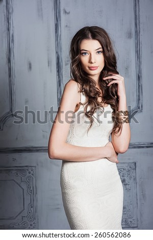 Beautiful young girl in a white dress - stock photo