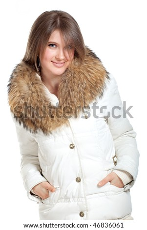 Beautiful young girl in a white jacket with fur collar - stock photo