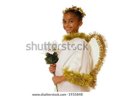 Beautiful young girl in an angel costume holding poinsettias
