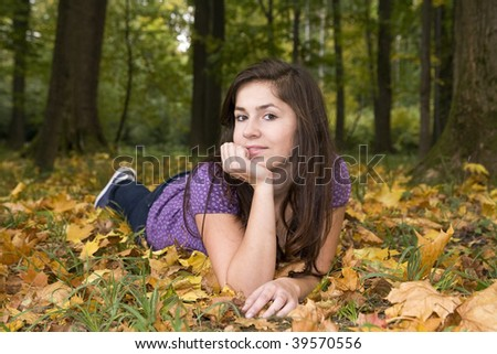 beautiful young girl in autumn scenery