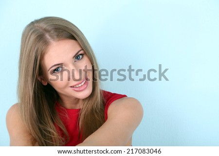 Beautiful young girl in dress on color background