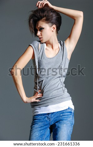beautiful young girl in jeans posing   - stock photo