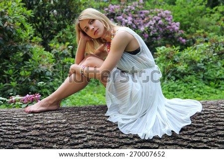 beautiful young girl in park - stock photo