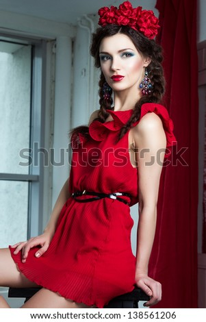 Beautiful young girl in red dress