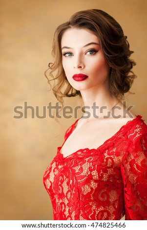 Beautiful young girl in red dress, indoor