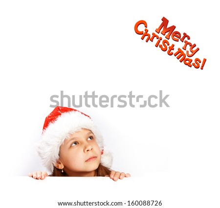 Beautiful young girl in santa hat behind white board. Space for text isolated on white.
