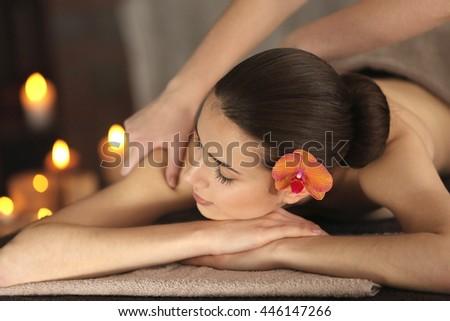 Beautiful young girl in spa salon - stock photo