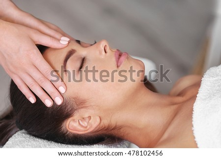 Beautiful young girl in spa salon