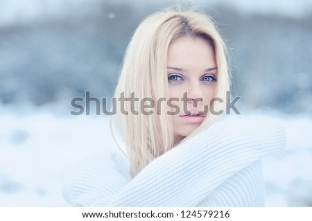 beautiful young girl in the cold winter air - stock photo