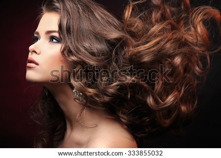 Beautiful young girl in the studio - stock photo
