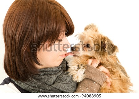 Beautiful young girl kissing the dog