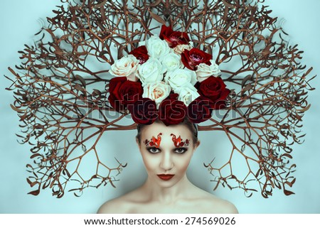 Beautiful young girl, lady, actress, model, character, tree, rose, fairy tale. Bold creative look, fashion style. Ideal expressive makeup, bright red lips, decor, accessory, headdress, branch, flowers - stock photo