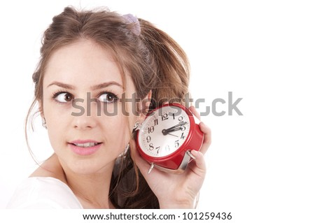 Beautiful young girl listening clock on a white background. - stock photo