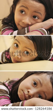 Beautiful young girl look emptily looking at the camera on the couch - stock photo