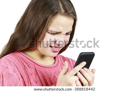 Beautiful Young Girl Looking at Her Phone
