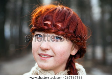 Beautiful young girl  on alley of   park. - stock photo