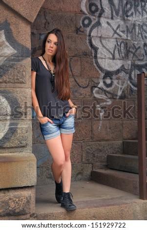 beautiful young girl on bridge - stock photo