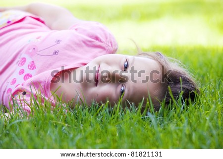 Beautiful young girl on grass