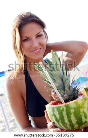 beautiful young girl on the beach - stock photo
