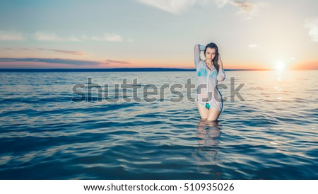beautiful young girl on the beach during sunset