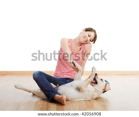 Beautiful young girl playing with a nice cute dog - stock photo