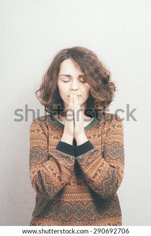 beautiful young girl prays - stock photo