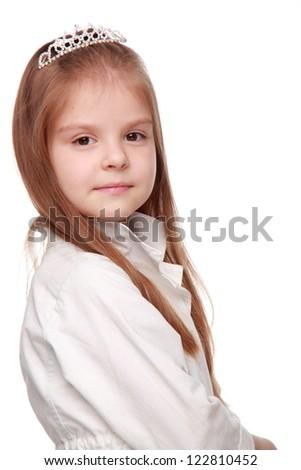 Beautiful young girl princess over white background