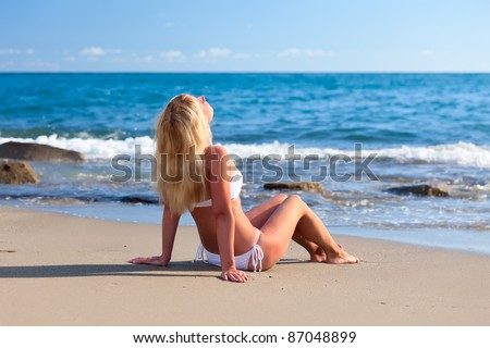 Beautiful Young  girl relaxing on the beach.