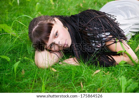 Beautiful young girl resting in meadow