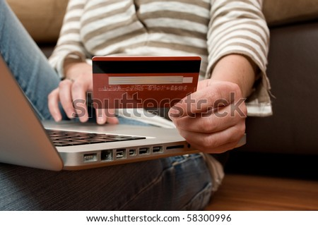 Beautiful young girl shopping online, e-commerce concept - stock photo