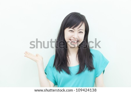 beautiful young girl showing copy space