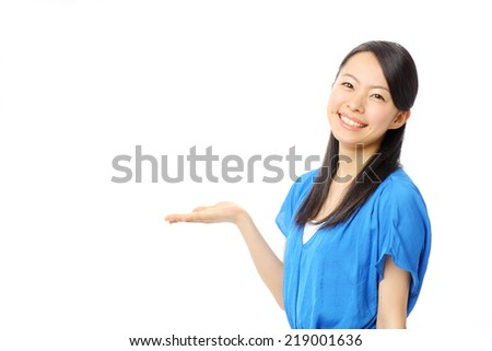 beautiful young girl showing copy space - stock photo