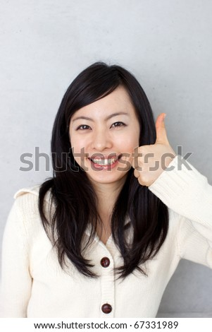 beautiful young girl showing thumb up - stock photo