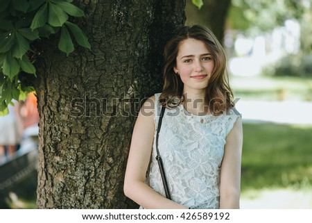Beautiful young girl smiling in the park. healthy new life image